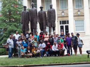 Freedom School Youth in front of the statue of the A&T 4 on North Carolina A&T State University. We are joined by our friends from Beloved Community Center on our grassroots people's history tour of Greensboro